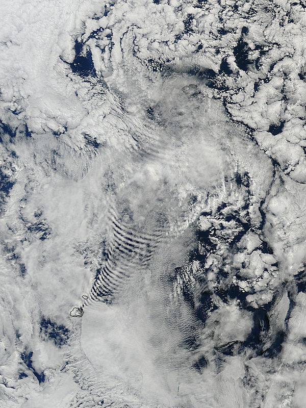 Image of Terra/MODIS 2013/085 06:45 UTC Ship-wave-shaped wave clouds induced by the Prince Edward Islands, south Indian Ocean<br>(morning overpass), Pixel size 1km