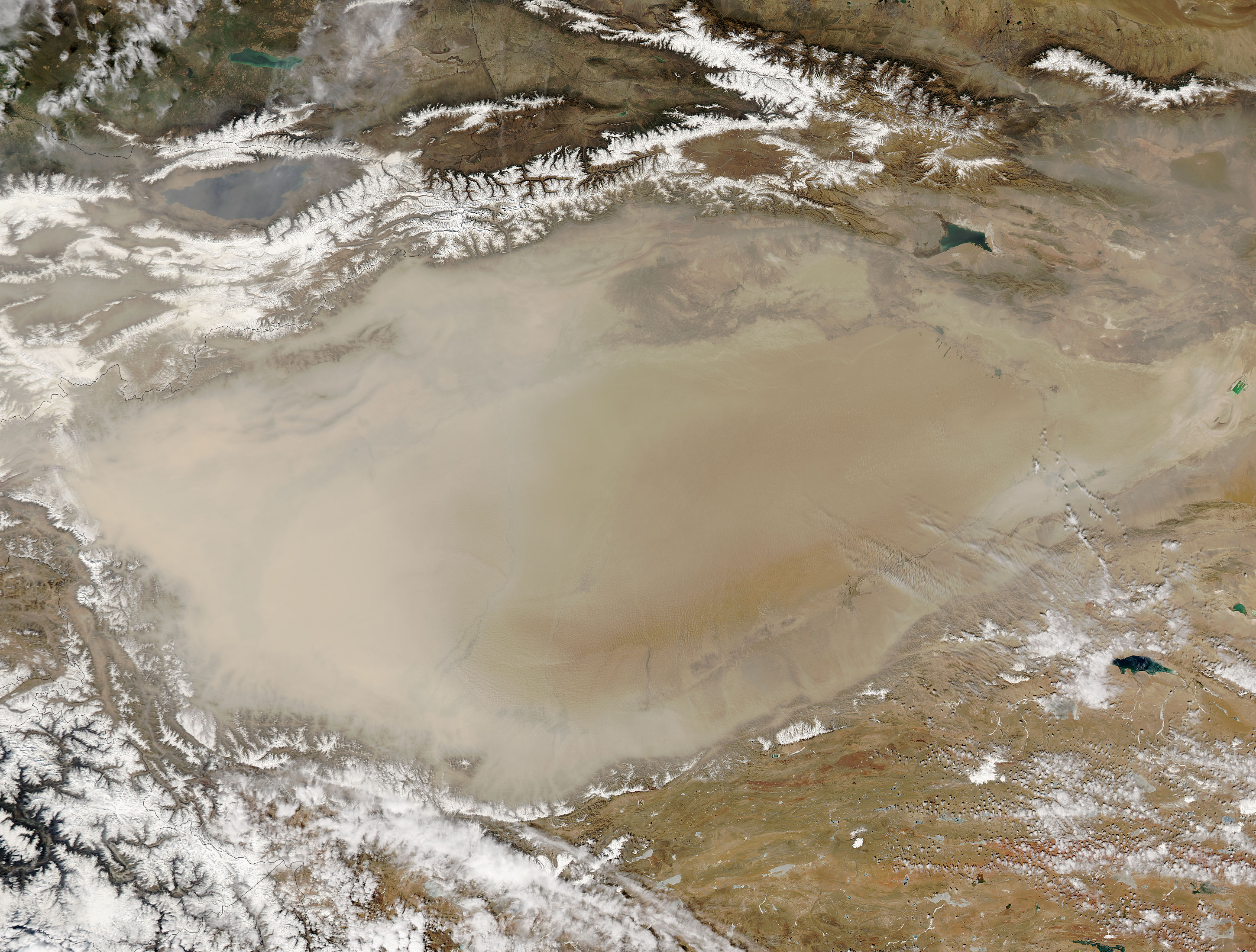 Image of Aqua/MODIS 2018/096 07:30 UTC Dust storm in Taklimakan Desert, Western China, Pixel size 500m